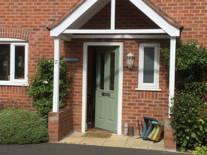 Welcoming home in village setting first floor