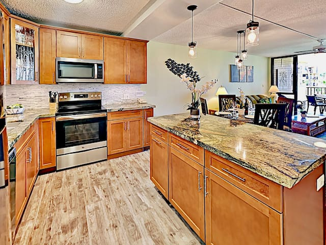 New and stunningly remodeled kitchen with granite countertops