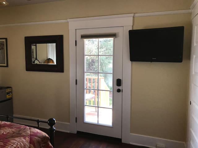 Tv on right wall and French door