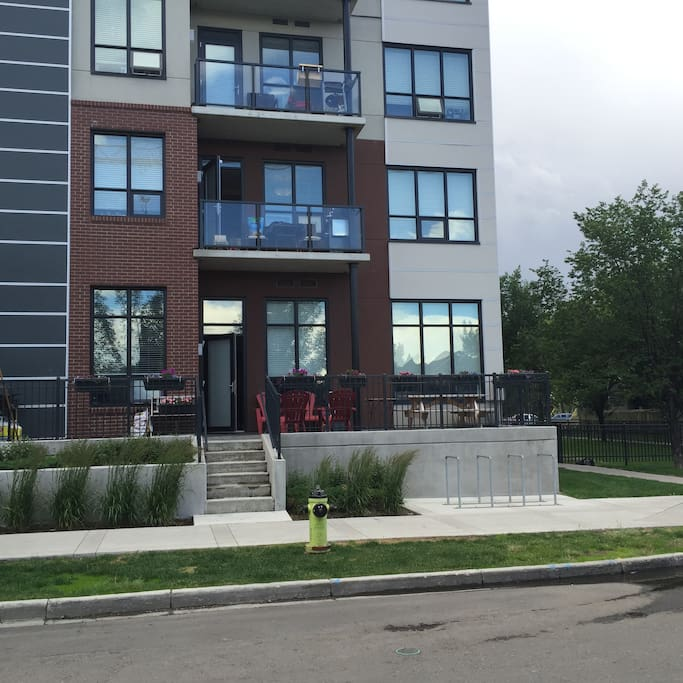 This is the view of street access to the unit. The patio door is 6 steps up from street level. Key access is via a lock box on the patio.