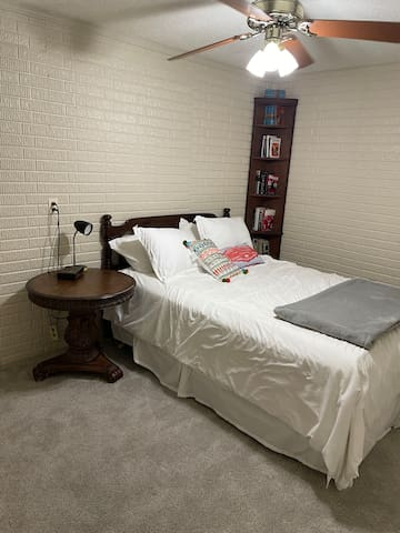 Queen bed, side table & closet.  Located behind kitchenette area.
