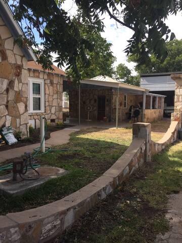 Side yard and entrance into back pavilion.