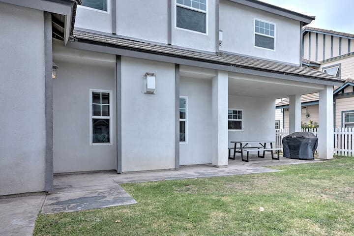 The rear of the house has a large grill and picnic table for outdoor dining.