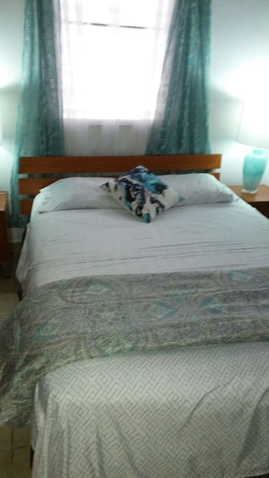 Queen size bed with air conditioned bedroom with ceiling fan also.