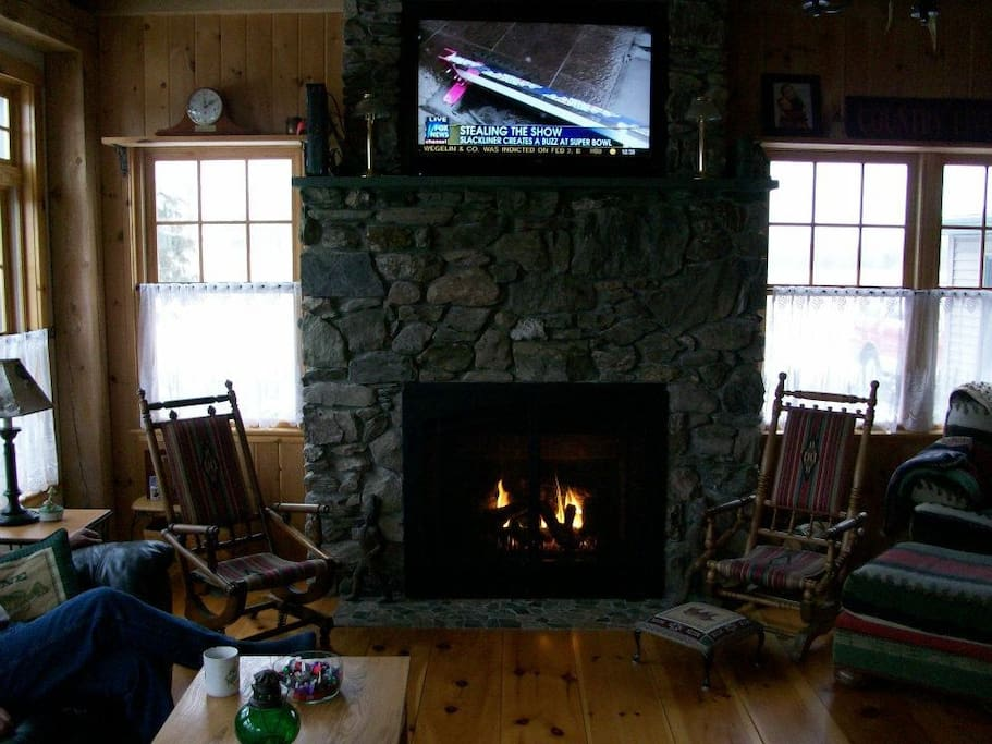 Relax in front of the gas fireplace after a day in town.