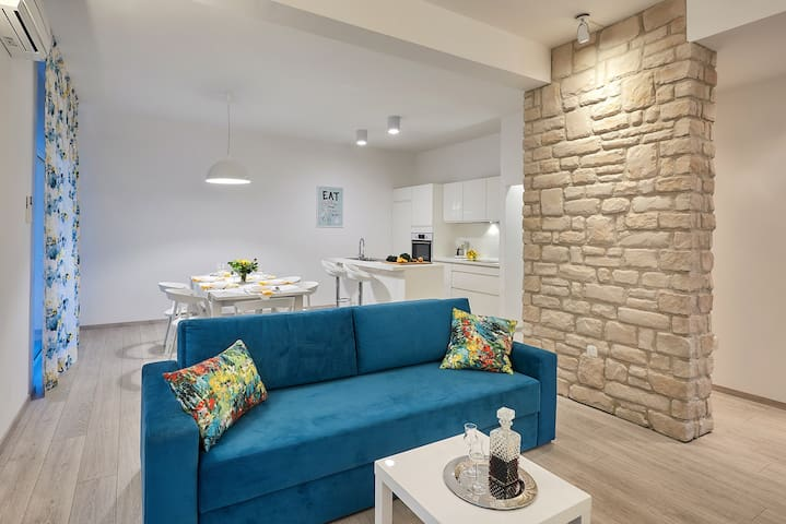 """OPEN PLAN LIVING/DINING ROOM """"Very comfortable apartment, spacious, modern, esthetic and well equipped, the pool and the garden is gorgeous and the hosts are very helpful. Thanks for all!"""" Anna"""