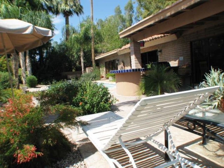 Pool area and terraces.  Lushly landscaped, private, quiet and secluded.