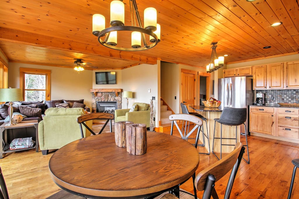 Pristine hardwood floors and ceilings create a mountain-cabin environment.