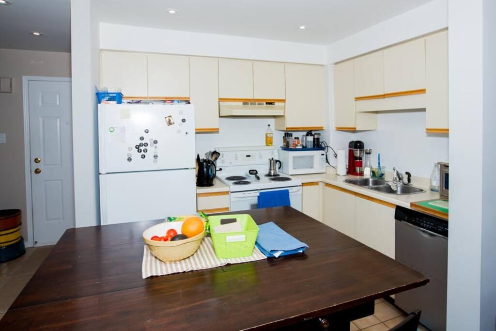 Shared Kitchen with microwave, dishwasher, fridge, stove, expresso machine
