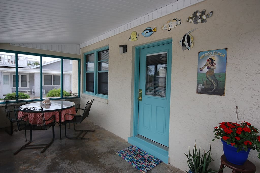 Great front porch for you to enjoy , feel the gulf breeze