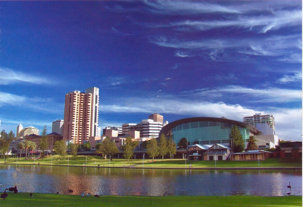 See that building on the far right?  The balcony right beneath those two top floor middle apertures are where you stand staring across at the views overlooking the River Torrens.