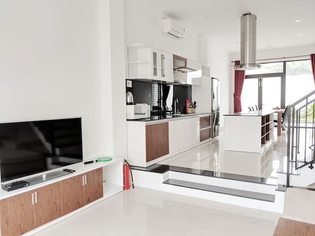 """50"""" TV with open island kitchen"""