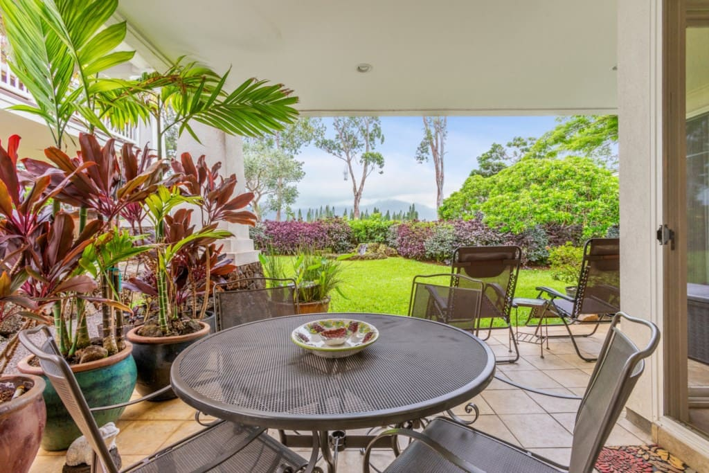 Private Lanai with two fountains, yard and view of Napali