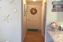 Hallway leading to bedroom, bathroom and roomy closet