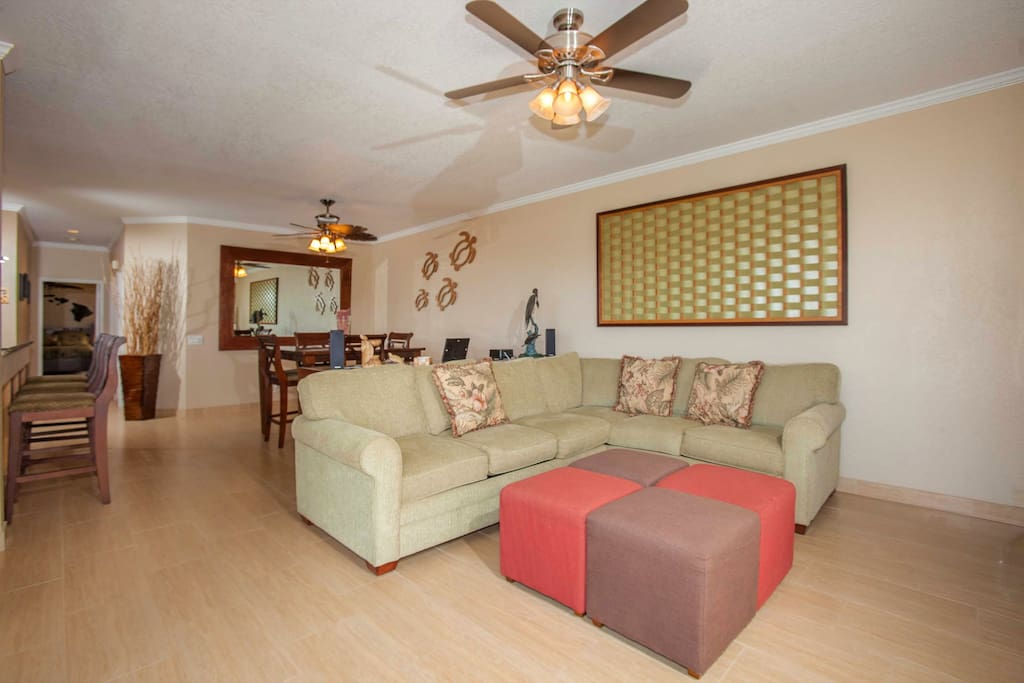 Large open floor plan with new sleeper sofa section and all one of a kind artwork.