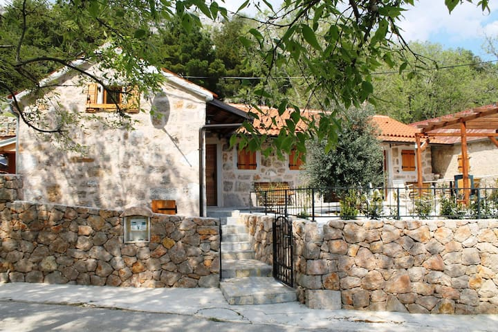 Traditional stone house with interiour pool, sauna, garden, terrace with BBQ