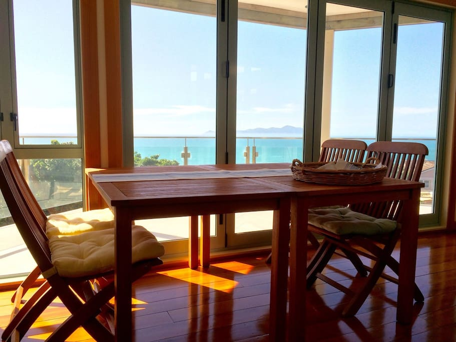 Guest dining area with view of Kapiti Island