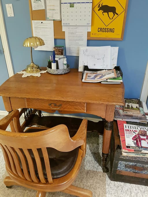 Antique desk, a favorite item of the host. There are a few vintage items in the room.