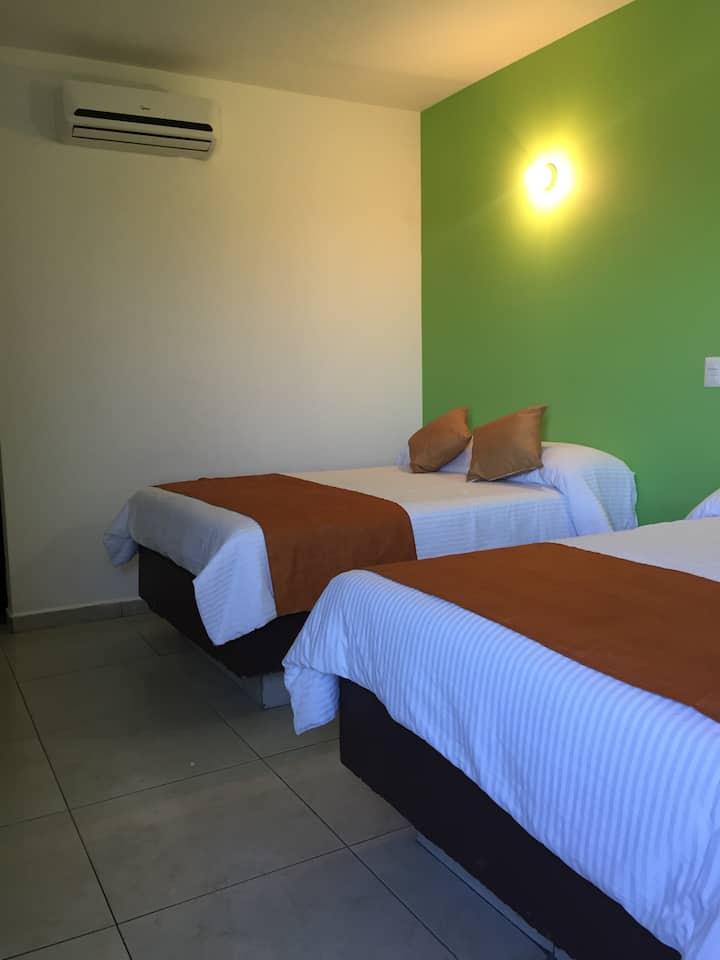 Habitación 2 camas, 4 personas, Hotel en malecón