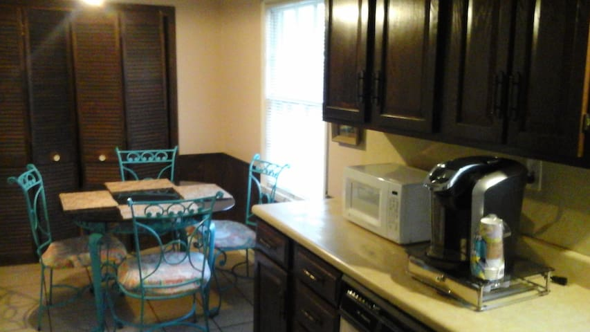kitchen, Keuric coffee maker, microwave, table with 4 chairs, view of back yard.