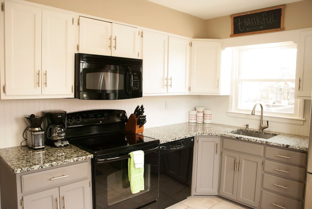 Newly updated kitchen boasts granite counters and everything you need to craft a delicious meal.