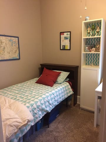 The second bedroom with closet, iron, fan, & space heater