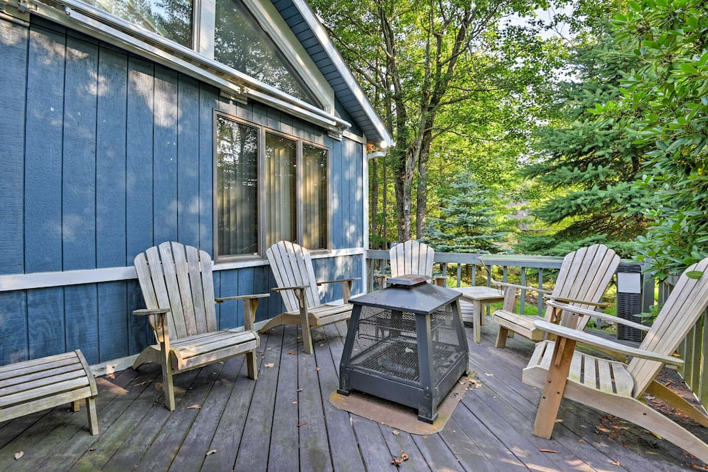Spend your days sitting on the deck, surrounded by trees.