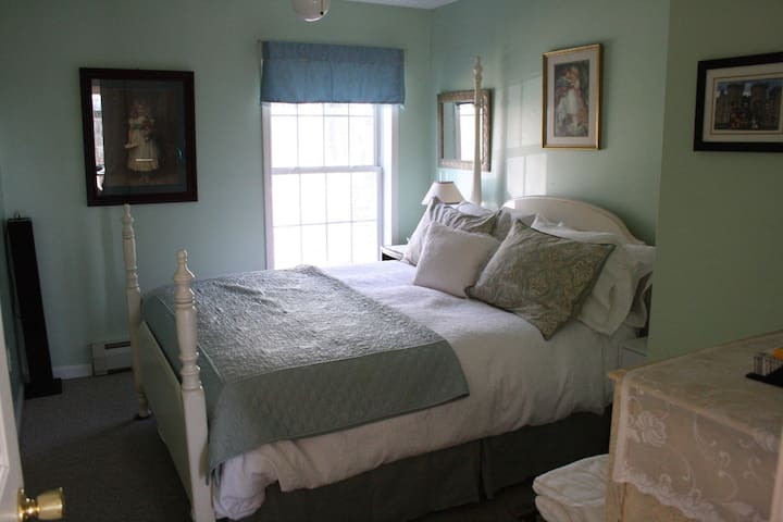 Beautiful mint-green bedroom w/ queen bed