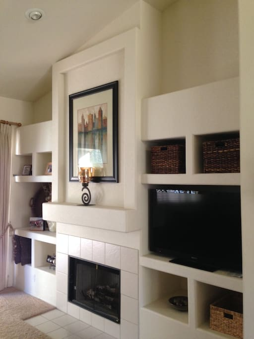 Living room area with flat screen TV, cable, and wireless Internet