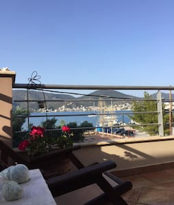 Maria's House with Poros view