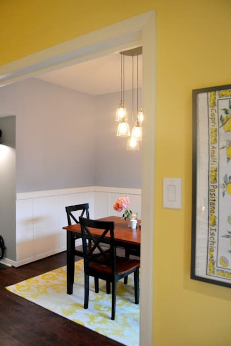 Kitchen Opens Up into Dining Area with 4 Top Table