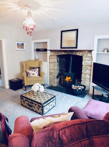 The comfy sitting room overlooks the front of the cottage. The wood burner is ready to use.