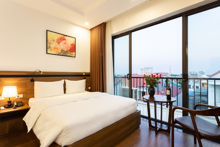 The room has a balcony, panoramic views over the city