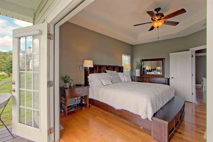 Master bedroom with amazing view. There is a Tv in front of the bed.