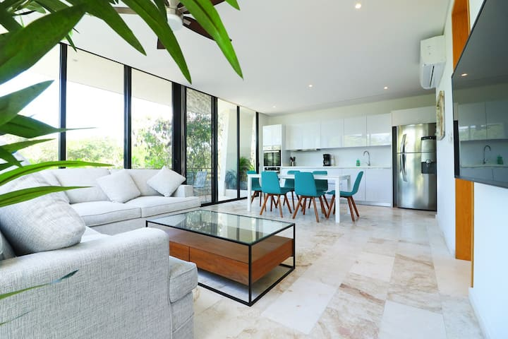 enter your light filled apartment with marble flooring with floor to ceiling windows