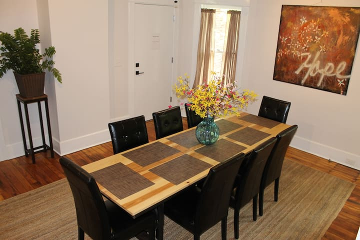 The living area opens to the dining table with room for eight.
