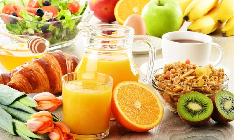 Luxury breakfast including fresh fruit, breads and rolls, coffee, thee, ...