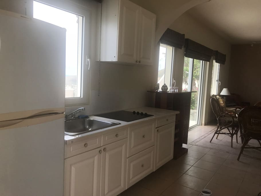 Kitchen next to main door with all utilities present including a Weber bbq