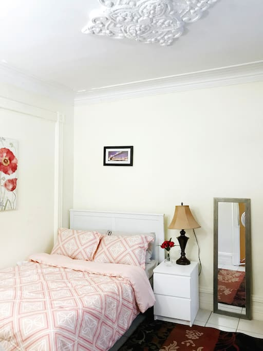 The larger room with a double bed and look at that beautiful crown moulding on the ceiling!