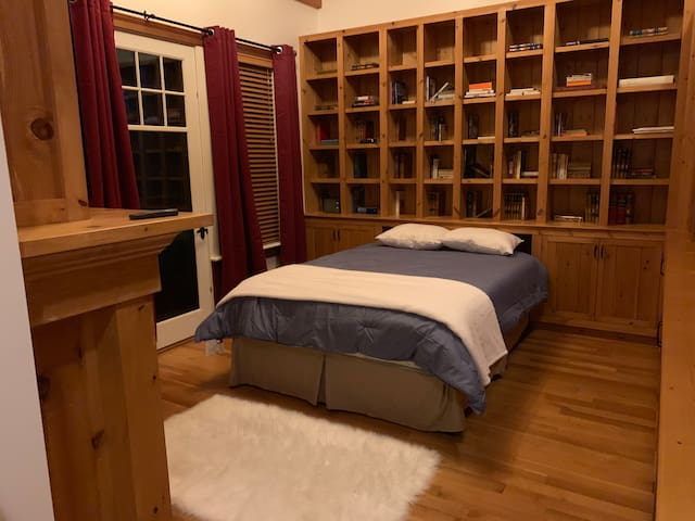 The library bed room features a gas fireplace and also shares the master bathroom. The room has a deck, waterviews, and connects with the pool.