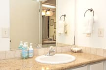 Main bathroom sink with granite counter.