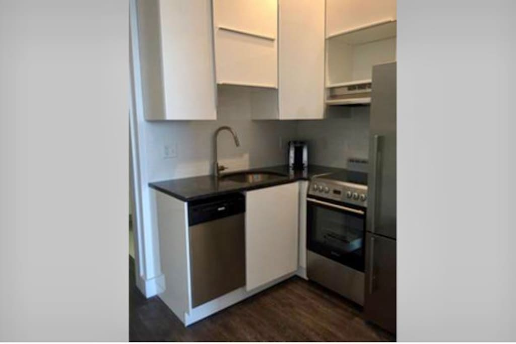 Full Kitchen with dishwasher, full refrig, coffee maker, microwave, stove and oven.
