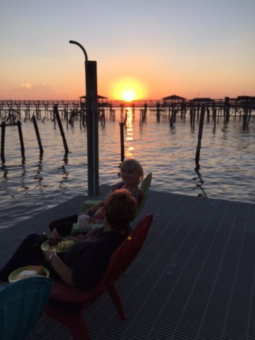 Relaxing on the dock at sunset.