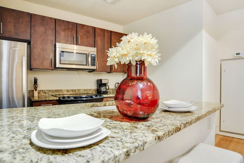 Fully equipped open floor plan kitchen with updated appliances and