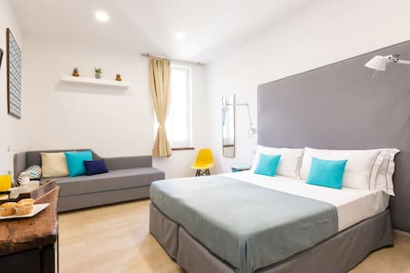 Bedroom - 1 King Sized Bed & 1 Single Bed OR 3 Single Beds, USB Sockets, Clean Towels and Fresh Bed Lines Provided, Latest Generation HD Flat Screen TV, Desk with kettle and coffee maker, Iron and Ironing Board, AC, Wi-Fi, Mini Bar, Wardrobe