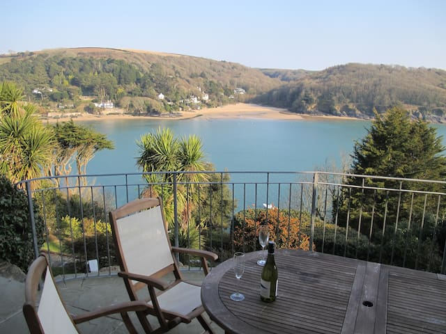 Relax on terrace as the sun sets illuminating Mill Bay