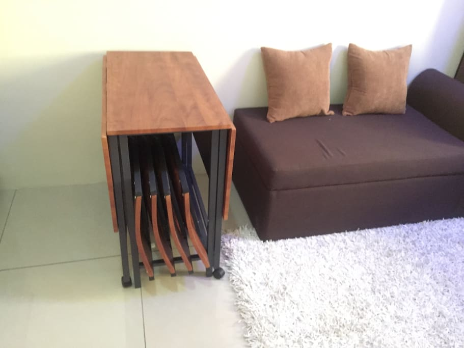 Space saving folding dining table with 4 chairs.