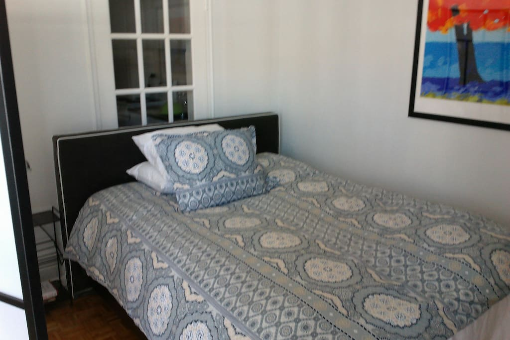 Super comfortable new bed, separated from the living room area by a divider