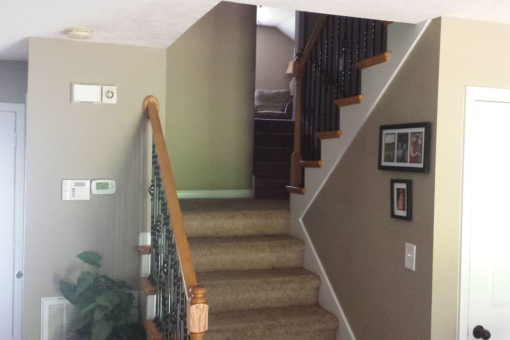 Stairs to bonus room and guest rooms and full bathroom