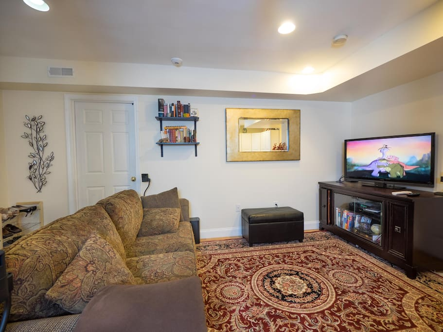 Living room with surround sound entertainment center and comfortable couch.